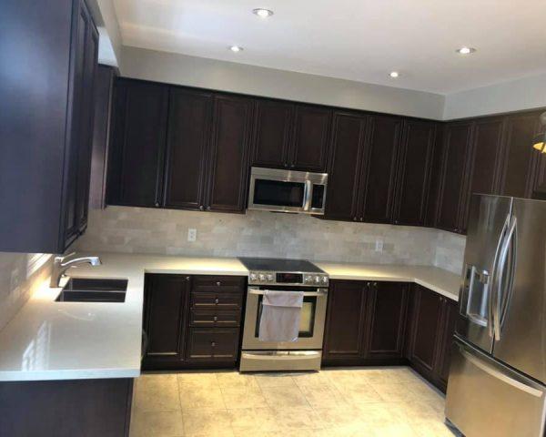 dark_brown_kitchen_white_granite_countertop