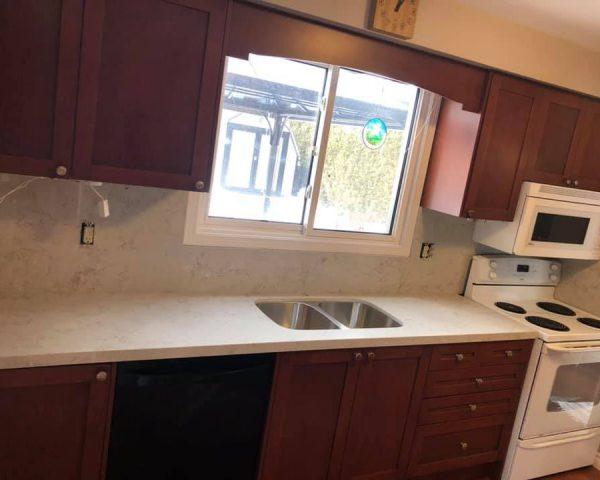 white_countertop_wood_kitchen