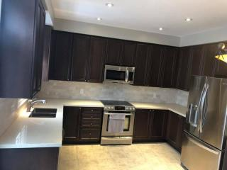 dark brown kitchen white granite countertop