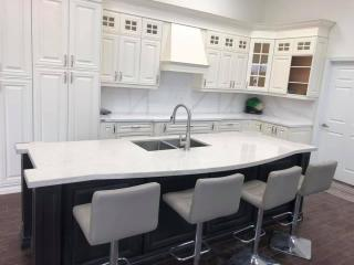 white countertop showroom white chairs